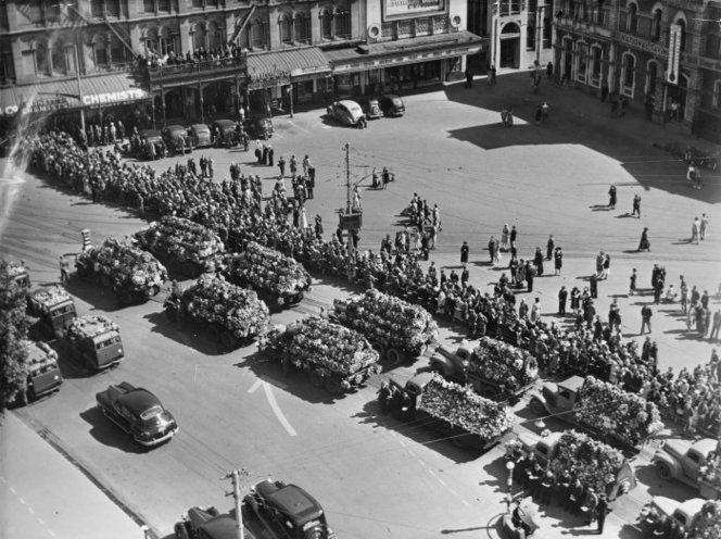 Trucks with wreaths in Cathedral Square, Christchurch, during the funeral service for victims of the Ballantyne's Department Store fire,. New Zealand Free Lance : Photographic prints and negatives. Ref: PAColl-7171-90. Alexander Turnbull Library, Wellington, New Zealand. /records/22739444