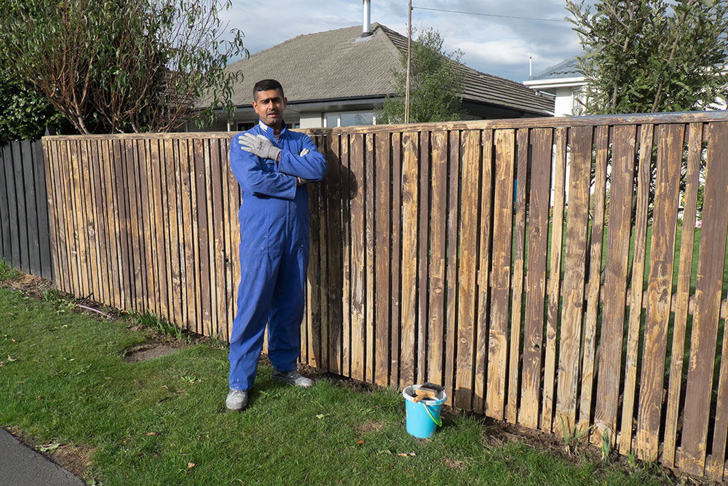 Ashwin painting the fence at Checketts Avenue. Photo by Ellenor Waters. CCL-HP2015-EW-DSCF3607