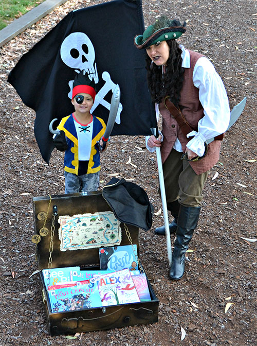 Captain Jane and her first mate, young book lover Alex Riley, guard some of the book sale loot.