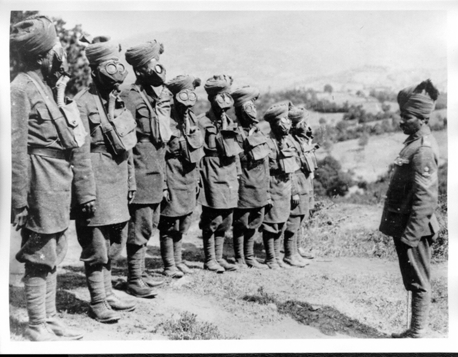 """Indian Troops at Gas Mask Drill.,"" by Unknown. The Imperial War Museum via First World War Poetry Digital Archive, accessed April 13, 2017, http://ww1lit.nsms.ox.ac.uk/ww1lit/collections/item/3616."