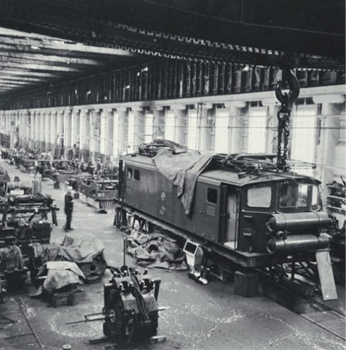 Christchurch to Lyttelton suburban Ec electric locomotive undergoing maintenance in the Addington Workshops [ca. 1960] CCL PhotoCD 11, IMG0054