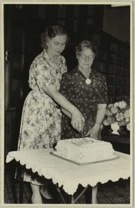 Linwood Public Library 50th Anniversary and annual meeting. Cutting the cake.
